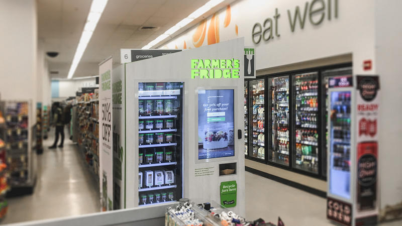 Interior view of a grocery store where a Farmer's Fridge kiosk is setup