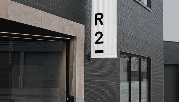 R2 logo printed white on a series of black business cards