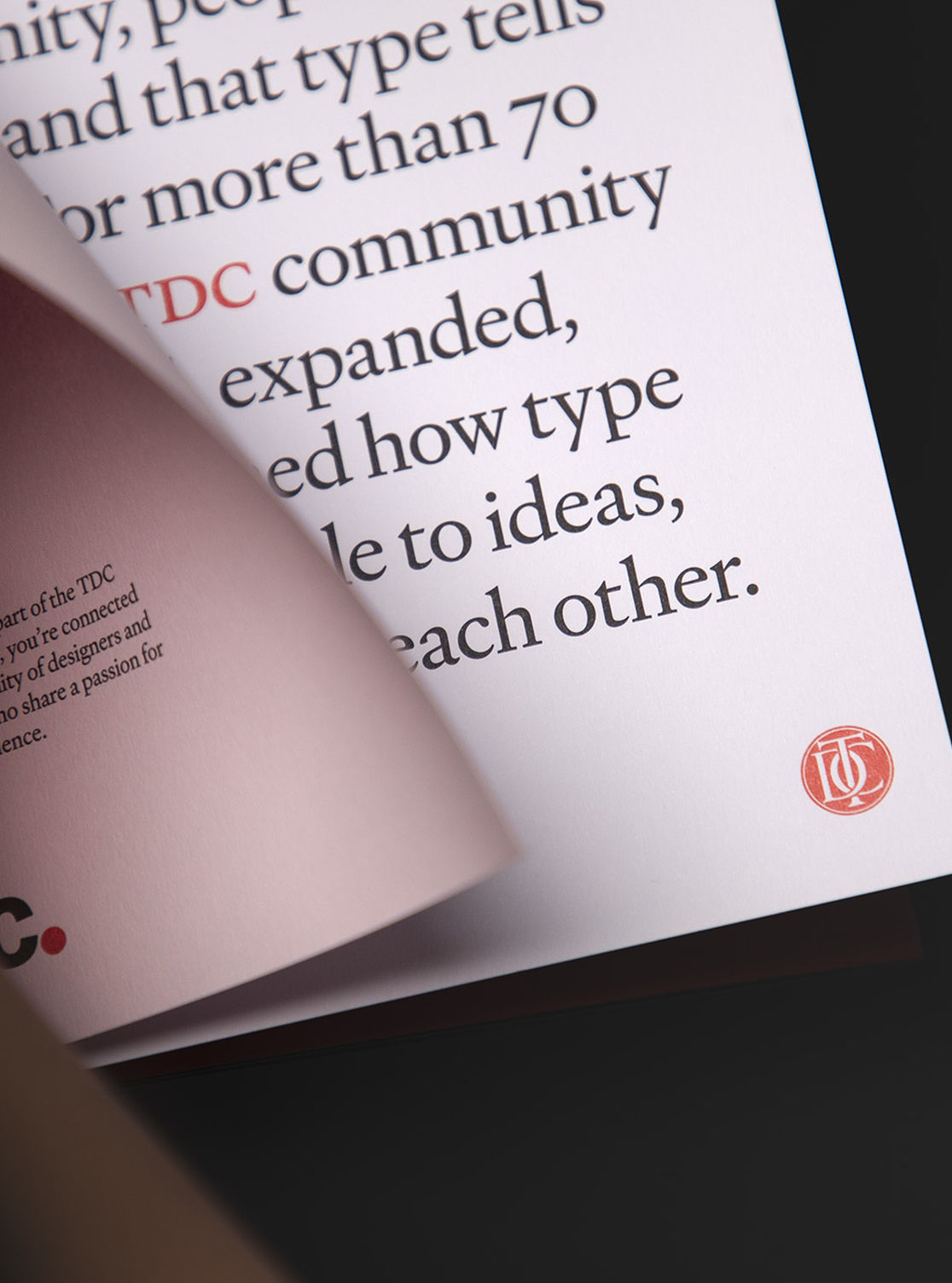 Interior detail of TDC booklet with large paragraph and monogram visible