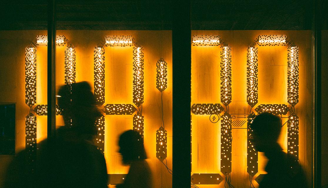 People walking past 88:88 Light Installation