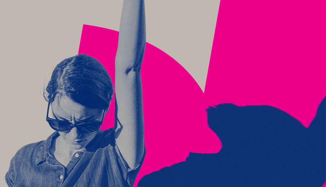 Individual woman looking strong wearing sunglasses with arm raised into the air on a pink and blue background