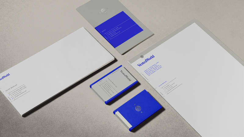 Vested World envelopes, business cards, letterhead and small booklet featuring logo and brand colors